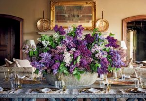 "The book gives lots of tips on designing and arranging – these are some lilacs that were picked and arranged by Kevin at Skylands. I love this color palette of purple and lavender mixed with the bold green foliage. (Photo from ""Martha's Flowers"")"