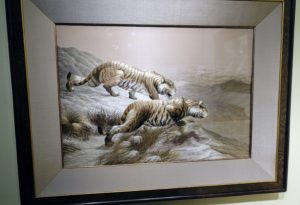 This is a Japanese silk embroidery of two tigers by Kyoto silk manufacturer Nishimura Sōzaemon. It is from the late Meiji period, also known as the Meiji era, a Japanese era which extended from October 23, 1868, to July 30, 1912. This period represents the first half of the Empire of Japan during which Japanese society moved from being an isolated feudal society to its modern form.