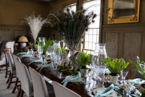 And here is a look at my long dining table before my guests arrived for lunch - the peacock feathers in the center look so marvelous along with the potted bird's nest ferns - so perfect for Easter.