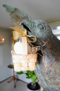This is my favorite photo from this year's Easter party - the giant 19th century gilded copper falcon - not eagle - holding a small basket with one single egg inside. I got this falcon because there are so many falcons and hawks flying around on the property - guests love seeing it as they enter my home. Please let me know about your Easter gatherings in the comments section below.