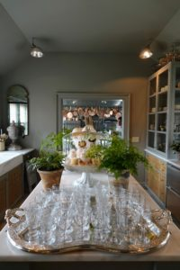 This is a view of my servery looking into my kitchen. I often serve beverages from this area whenever I entertain. It is a popular space for guests to gather.