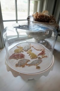 "Underneath this cake stand dome, Laura placed glittered wooden ""cookies"" - these, too, almost look too real."