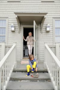 Here I am in front of my kitchen door as my grandson, Truman, gets his sneakers on to head down to the egg hunt.