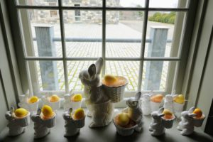 Here is the wide windowsill inside the Carriage House looking out onto the cobblestone courtyard. All these porcelain bunnies were from previous Macy's collections. Macy's now carries very charming porcelain bunny salt and pepper shakers from the Martha Stewart Collection. Take a look on their web site. goo.gl/RTfcsi