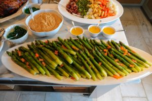 I have these giant asparagus delivered to me every year from Mr. Spear in California. Chef Pierre likes to peel the bottoms of the asparagus stalks and then tie the asparagus in bunches before blanching. They are served with these bunny-shaped carrot cutouts and mustard vinaigrette. http://www.misterspear.com