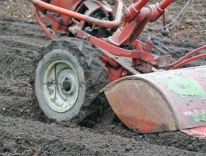 The machine is set to till the soil at about six to eight inches deep.