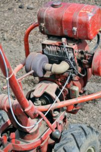 Most tillers have an accelerator on or near the handle or on the engine. On some tillers, the speed of the rotating tines helps determine the speed of the machine.