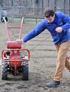 Here is Ryan starting up the rototiller for another pass through the beds. This vegetable garden is quite large, so it takes time to rototill the entire space, but it's well worth the effort.