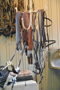Inside the tack room, bridles, harnesses and saddles are cleaned regularly.