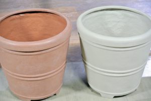 These are the 12-inch round planters in terracotta and gray. These pots are lightweight and save so much soil because of the removable false bottom.