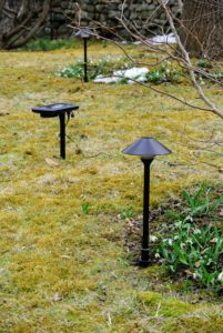 These tethered lights provide the look of low-voltage garden lighting.