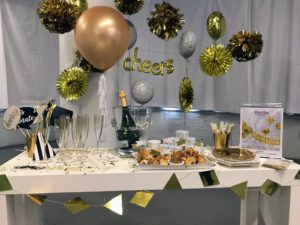 This gold color theme was set up for a bridal shower, but can be used for an anniversary as well! I love the gold mylar balloons and pompoms. The big gold balloon is 36-inches in diameter made of latex. It comes with four white tassels and a six-foot long curling ribbon.