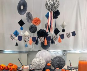 The indigo decor kit contains six tassles, two banners, two pompoms, two 11-inch lanterns and one nine-inch lantern.