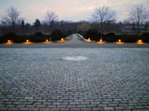Here are two sets lighting the foot of my boxwood allee. The lighting appears yellow as the sun begins to set, but they are actually white.