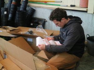 Ryan carefully checks the packing slip to ensure all the boxes and specimens arrived.