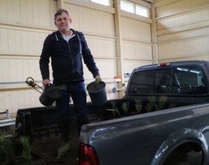 Fernando loads the potted specimens onto the pick-up truck, so they can be transported to the stable parking lot.