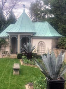 This is the Chanticleer Pool House - the pool is located just behind the pots of Agave americana.