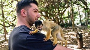 Here is Zenel with a squirrel monkey. This monkey was actually more interested in Shqipe and quickly jumped on her after this photo was taken.