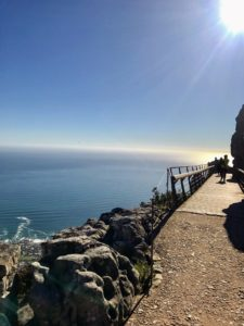 Here is another view from the top of Table Mountain. Table Mountain is a flat-topped mountain forming a prominent landmark overlooking Cape Town and is a popular tourist attraction, with many visitors using the cableway or hiking to the top.