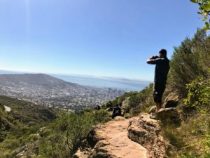 Shqipe and Zenel also hiked up Table Mountain, which took about two hours to reach the summit. Here is Zenel taking some photos of the city of Cape Town in the distance.