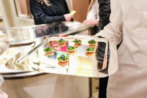 This tray is filled with asparagus tartlets with celery leaf pistou. (Photo by Neil Rasmus/BFA.com)