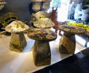 I saw these stones right away - I have very similar ones back home at my Bedford farm just waiting for the perfect location. They are called staddles. Staddle stones were originally used as support bases for granaries, hayricks, and game larders. They typically looked like giant stone mushrooms or toad stools.