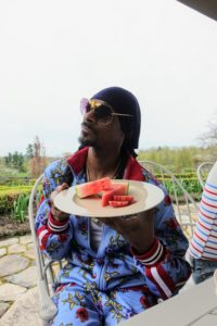 Snoop posed with his dessert plate of watermelon and blood red orange slices.