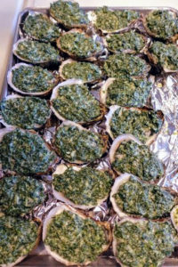 We also served Oysters Rockefeller made with Copps Island oysters. Oysters Rockefeller consists of oysters on the half-shell that have been topped with a rich sauce of butter, parsley and other green herbs, and bread crumbs, then baked or broiled. http://www.coppsislandoysters.com/