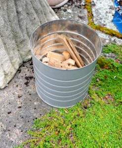 We use wooden shims under the pots to ensure good drainage for the season.