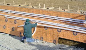 And PVC pipe is installed and extended to the mechanical equipment location on the other side of the paddock. These pipes accommodate the main drain and all the other mechanical lines for the pool.