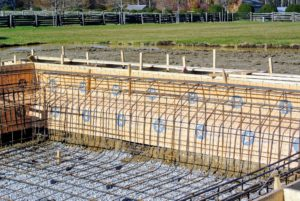 The next step is to install steel reinforcing bars inside the pool to strengthen the shell.