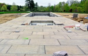 The pool is now coming to life - the stone pavers around the pool and patio area are installed. The stone is from Luppino Landscaping and Masonry. http://luppinolm.com/