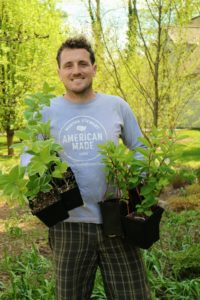 Here is Ryan with some of the latest plants ready to go into the ground. These plants are called Solomon's Seal, or Polygonatum.