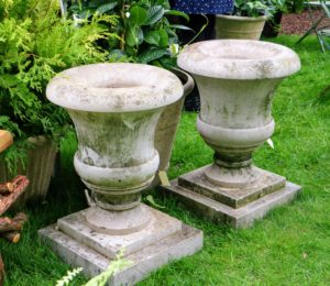 Here are two elegant stone urns - perfect for planting on the next sunny day.