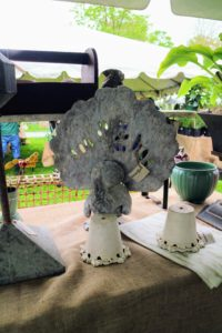 Here is one of two metal tabletop peacocks from Hunter Bee. It reminded me of my dear peafowl back at the farm.