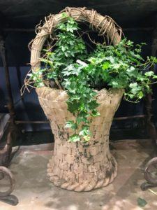 Here is a stone basket planter - many of the planters were already filled with lovely specimens.