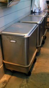 On the other side of the pantry, I use these large stainless steel commercial bins for storing some of my other baking needs such as flour. I love these rolling bins - I also use them to store planting mediums in my greenhouse head house and in my stable to store grains for my horses.