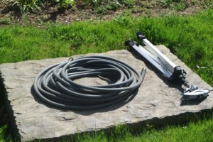 This hose and sprinkler are by my Stewartia garden, across the carriage road from my long clematis pergola.