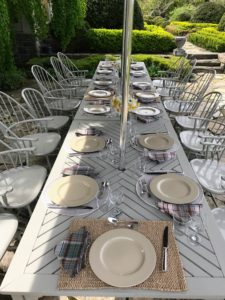 We set the table in simple, neutral tones with Wedgewood drabware plates and gray plaid napkins.