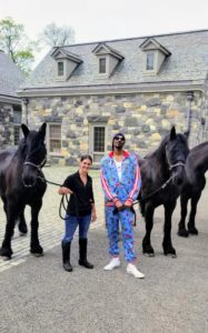 Snoop loved meeting all my horses. Here he is with three of my five Friesians and my stable manager, Sarah.