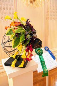 This is by Tracey Burhoe of Ashland, New Hampshire. It includes hosta leaves, begonia leaves, calla lilies, and ivy. It won a 'best in show' award for floral design. (Photo courtesy of The Preservation Society of Newport County)
