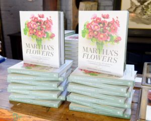 "Copies of ""Martha's Flowers"" were fancifully displayed on tables around the space - visitors perused the many stunning photos while enjoying cocktails and hors d'oeuvres. (Photo by Madison Voelkel, BFA.com)"