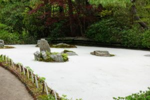 """The """"sand garden"""" was inspired in size to the celebrated garden of Ryoan-ji in Kyoto, dating from about 1480. Ryoan-ji is a Zen temple in Japan. The garden is considered one of the finest surviving examples of karensansui, or dry landscape."""