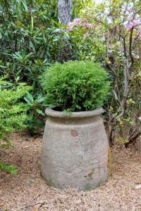 Lovely stone planters are positioned around the garden also look very Japanese.