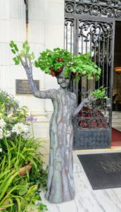 "Here is one of several walking green ""tree ladies"" provided by Ten31 from Providence. They featured what is called a ""tableaux vivant"" meaning living picture act for guests. https://www.ten31productions.com/"