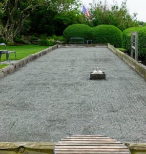 This is a bocce ball court. Bocce is traditionally played on natural soil and asphalt courts that are 90-feet in length and 8.2 to 13.1 feet wide. I used to have one at my Bedford farm - it was later replaced by a large daffodil bed behind my Tenant House.