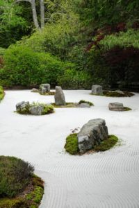 """This """"sand garden"""" built along the eastern edge of the stream, uses rocks and raked sand to suggest islands surrounded by flowing water. The sandy area is offered to visitors as places for quiet contemplation."""