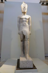 This is a colossal statue of a Ptolemaic king, Thonis-Heracleion, from the Ptolemaic period 332-30 BC. It is made from pink granite.