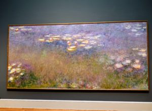 This stunning painting by Claude Monet, 1840-1926, is called Water Lilies, c.1916-26. It is done with oil on canvas.