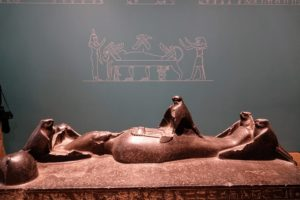 This is Osiris on his funeral and revival bed, 1773 to 1650 BC. It represents Osiris when Isis revives him with the breath of her wings. It is 70-inches long.